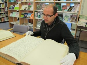 Bhaskhar Adhikari consulting one of RBGE's copies of the Wallich Catalogue
