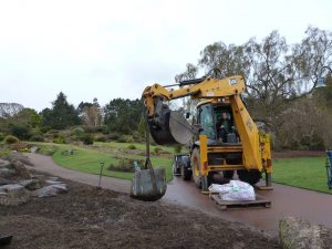 Heavy machinery on iste to shift rocks in to place