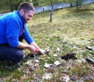 Andy Scobie, Cairngorms Rare Plants Officer, reburying seed packets.