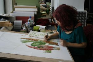 Isik working on the painting of Gunnera.