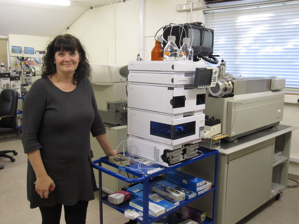 Wendy with masspectrometer at the Rowett Institute of Nutrition and Health that has been used to analyse the chemical profiles of the crops for compounds linked to maintaining health.