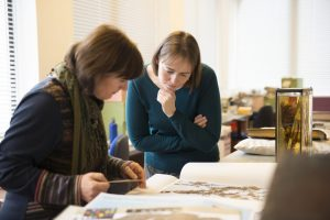 Behind the scenes - Elspeth Haston and Lorna Mitchell looking at potential items to include in the Botanical Treasures publication