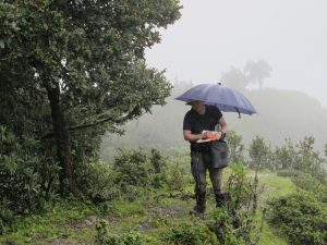 Dr. Patrick Kuss working in a monsoon cloud