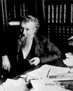 john_muir_sitting_at_his_desk_photo