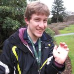 MSc student Tom Dawes with one of the moths from the Garden's new moth traps.