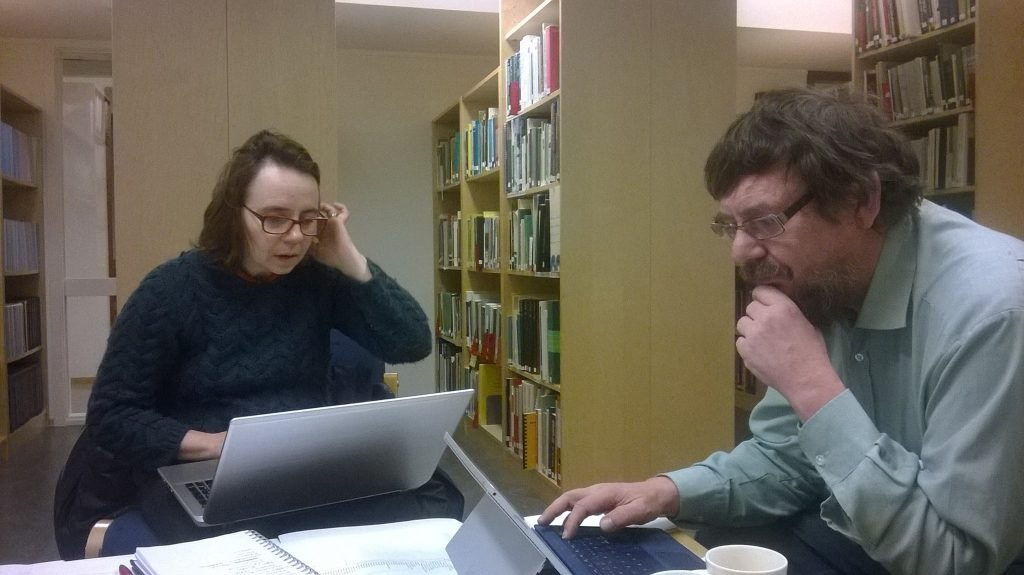 Ana and Lars compare names in the Museum library