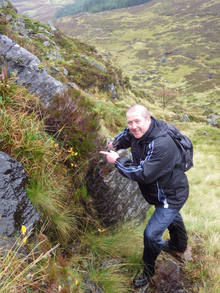 Graeme Dey pointing to healthy specimens of Salix lanata which were planted by RBGE and SNH as part of their Recovery Programme.