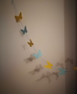 A finished example of the butterfly garland from the craft activity