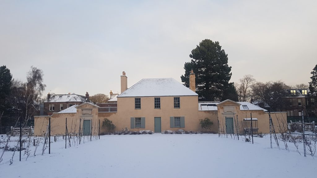 Image shows the Botanic Cottage in the snow