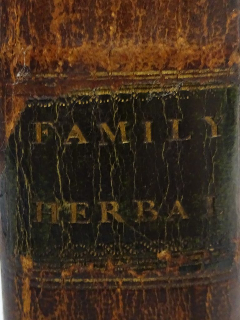 To show the leather title label on teh spine of John Duncan's copy of John Hill's Family Herbal
