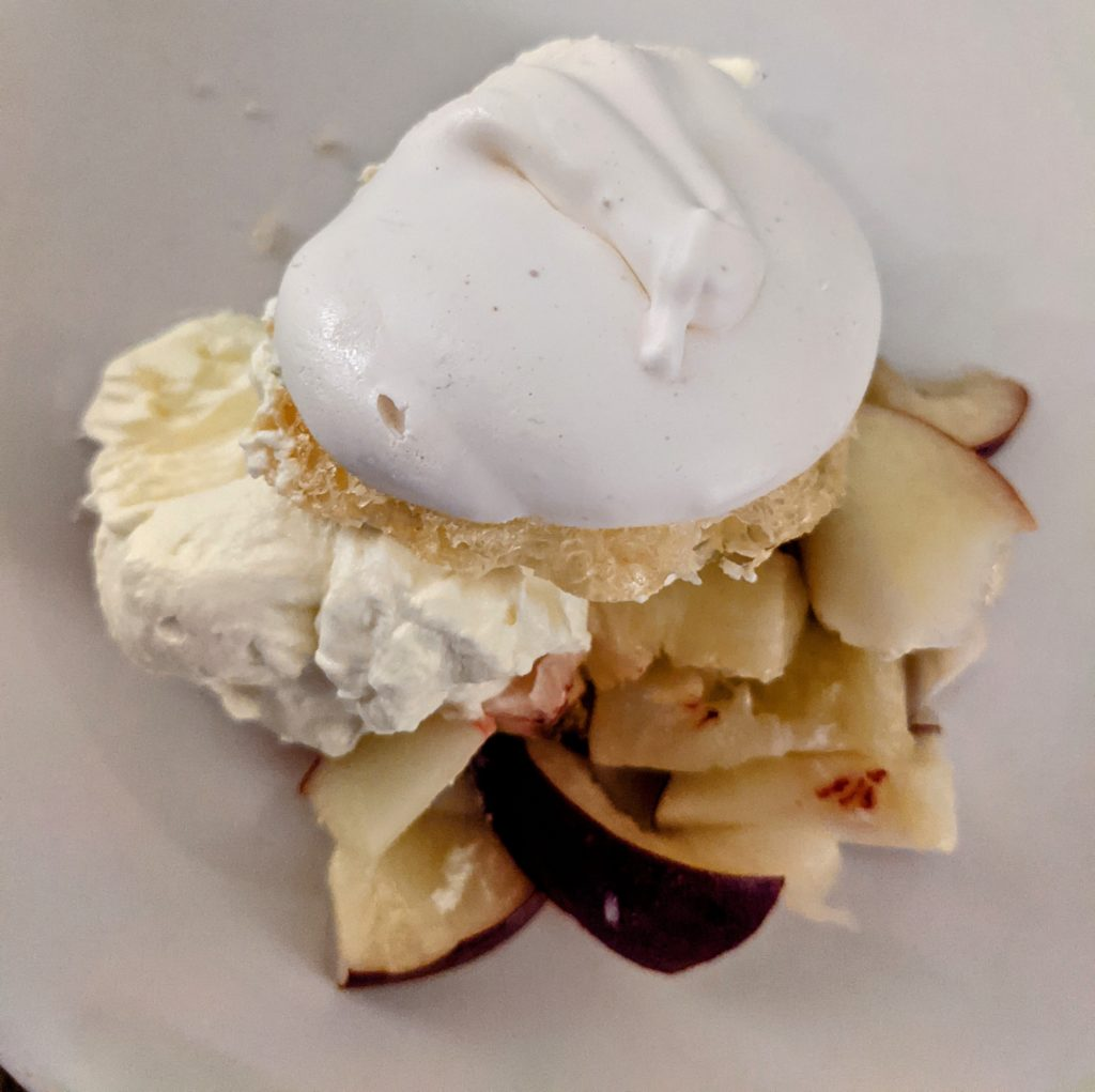 A baked meringue with fruit and cream.